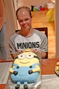 Most happy with his Minions Theme Birthday and the birthday cake.